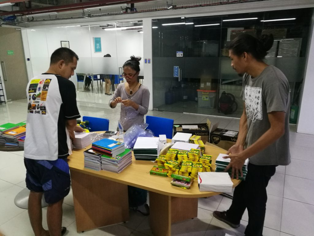 employees in photoup packaging school supplies for bayobay elementary school